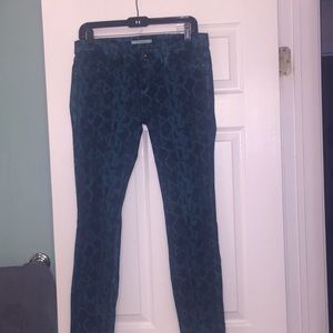Rich and skinny teal colored snake print jeans